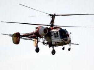 Insecticid împrăştiat din elicopter, peste mai multe localităţi afectate de inundaţii