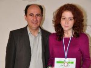Iustina, împreună cu cel care a pregătit-o, prof. dr. Petru Crăciun