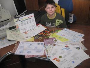 Mihai a participat la numeroase concursuri, întorcându-se de la majoritatea cu medalii, premii şi diplome