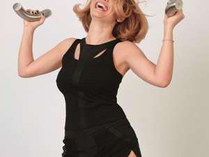 Andreea Esca, fotografiată de soţul ei, într-un pictorial al revistei Ce se întâmplă, doctore?