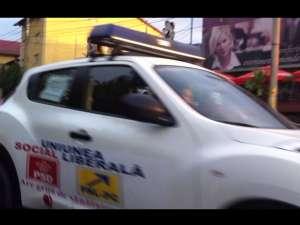 Maşini cu girofar şi sigla USL, în campanie electorală prin judeţ