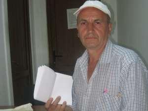Bărbatul amendat, Vasile Duţuc, consideră că punga cu hoitul în putrefacţie ar fi un act de ameninţare