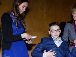 Sebastian Remus Crăciun este un copil diagnosticat cu tetrapareză spastică