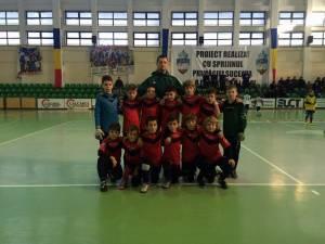 Antrenorul Andrei Iţco împreună cu jucătorii care au reuşit această frumoasă performanţă