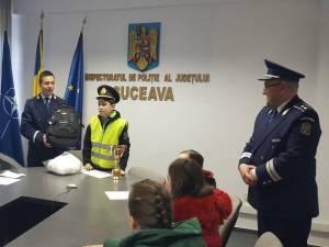 Elevul premiat de poliţişti