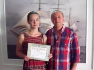 Daniela Petrovici alături de prof. Gheorghe Cirstian