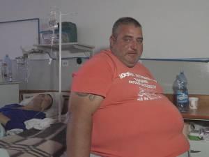 Obez, cu probleme varicoase şi cu hernie ombilicală, Oliver Postolachi nu avea cum să ajungă în apartamentul său