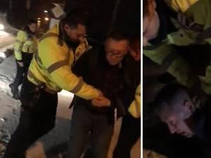 Imagini de la intervenţia agenţilor de poliţie, pentru încătuşarea bărbatului din Brodina