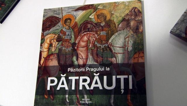 Cartea-album care prezintă istoria bisericii monument UNESCO de la Pătrăuţi