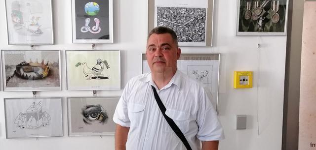 Caricaturistul Ovidiu Ambrozie Bortă BOA , organizator şi membru al juriului