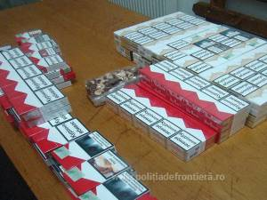 Ţigări ascunse în cutii cu prăjituri şi cereale, descoperite în PTF Siret
