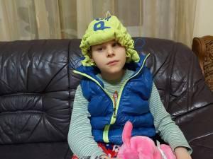 Iustin Gabriel Piticaru suferă de diplegie spastică - formă ataxică