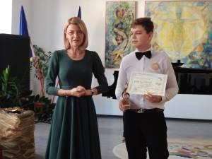 Alexandru Vlădianu, clarinet, alături de adjuncta Elena Istrate