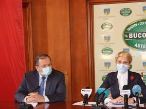 Președintele Consiliului Județean Suceava, Gheorghe Flutur, şi ministrului Muncii și Protecției Sociale, Raluca Turcan