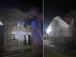 Incendiu puternic la o casă, pornit de la un fier de călcat