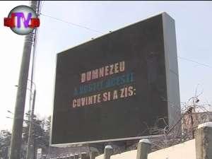 """A investit mii de euro într-un panou publicitar, pentru a-i face """"reclamă"""" lui Dumnezeu"""