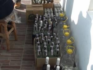 O armată de poliţişti a descins ieri dimineaţă împotriva comerţului sătesc cu alcool contrafăcut